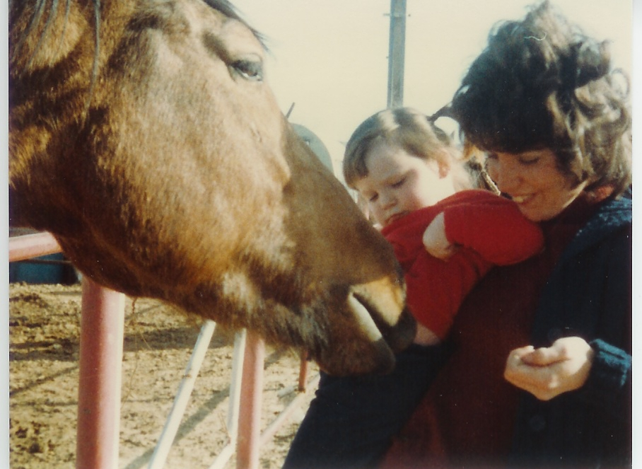 My mom and I and a horse... eating out of my pocket!